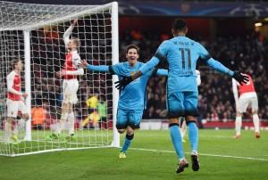 Messi celebra con Suarez