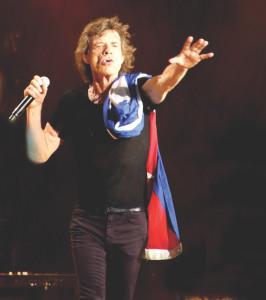 Mick con la bandera de Cuba
