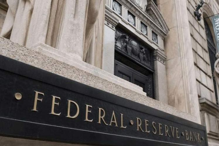 Federal Reserve officials project rate increases in 2023